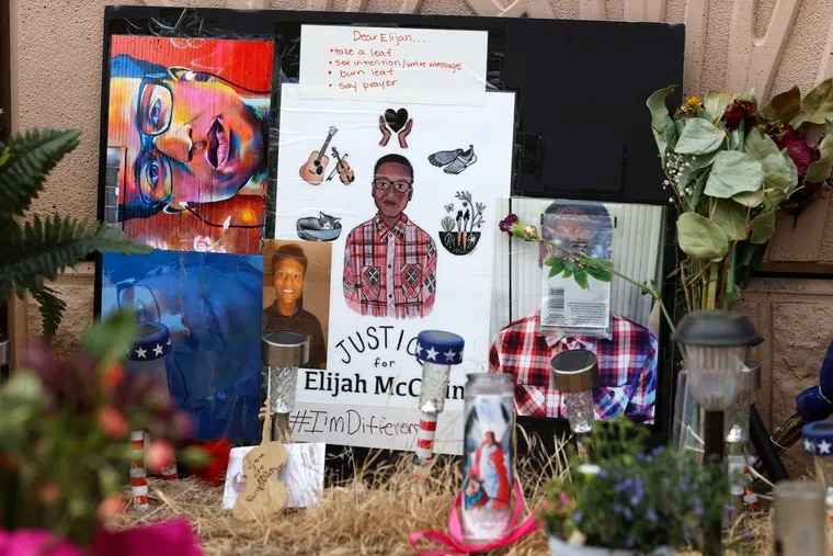 A makeshift memorial stands at a site across the street from where Elijah McClain was stopped by Aurora, Colo., Police Department officers while walking home before family members hold a news conference July 3.