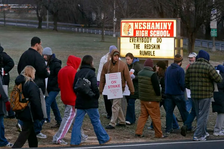 Sign outside Neshaminy High School with the Redskins name and logo