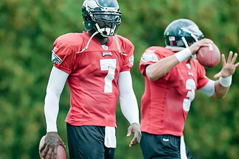 Mike Kafka (right) is expected to back up Michael Vick at quarterback next season. (Clem Murray/Staff file photo)