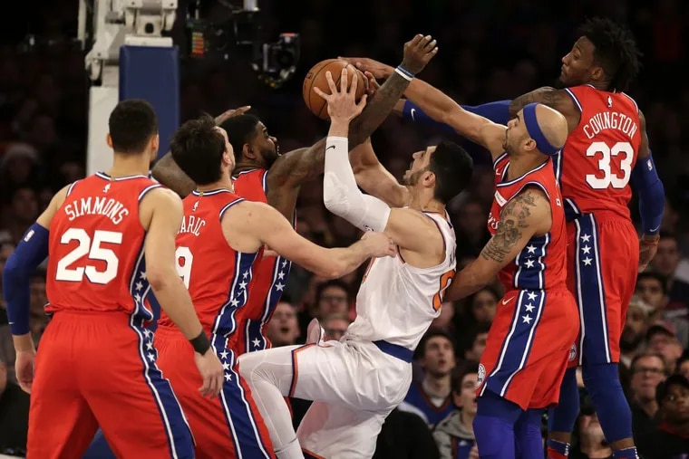 Sixers defenders swarm over the New York Knicks' Enes Kanter during the second half of Monday's 105-98 win.