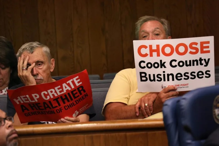 In Cook County, Illinois, a supporter of the beverage tax and an opponent sit side by side at a public meeting on the issue.