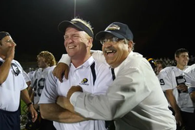 Coach Joe Frappolli of Florence (right) and offensive line coach Tony Luyber savor Frappolli's record 231st victory. (See M )