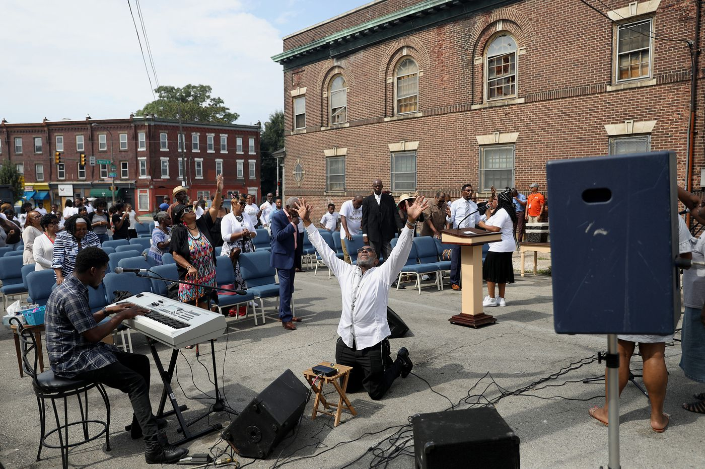 After fire destroyed their church, Greater Bible Way Temple members worshiped in the street on Sunday