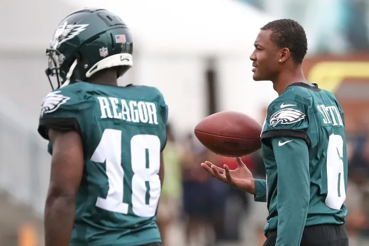 Eagles wide receiver Jalen Reagor and the injured DeVonta Smith during training camp at the NovaCare Complex on Tuesday.