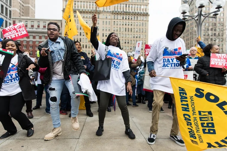 Attendees dance in Thomas Paine Plaza at the Working People's Day of Action labor rally in February.
