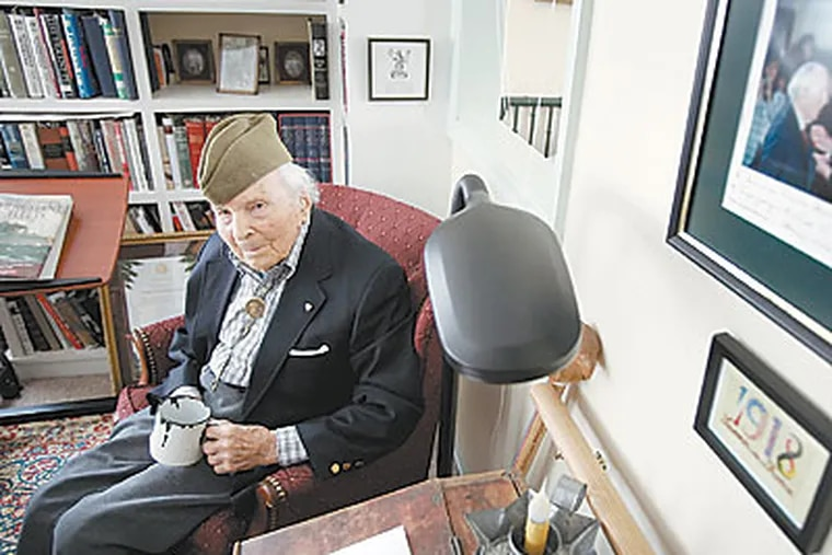Frank Buckles, the last living American WWI veteran, wearing his WWI uniform hat and clutching the cup he used as a prisoner of the Japanese during WWII at his home in Charles Town, W.Va. on Jan. 27, 2009. (Laurence Kesterson / Staff Photographer)