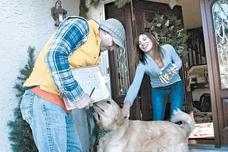 In Haddon Township, N.J., John Friers goes door to door asking folks about whether their dogs are properly licensed. Here, he visits the home of Nina Swallow. ( April Saul / Staff Photographer )