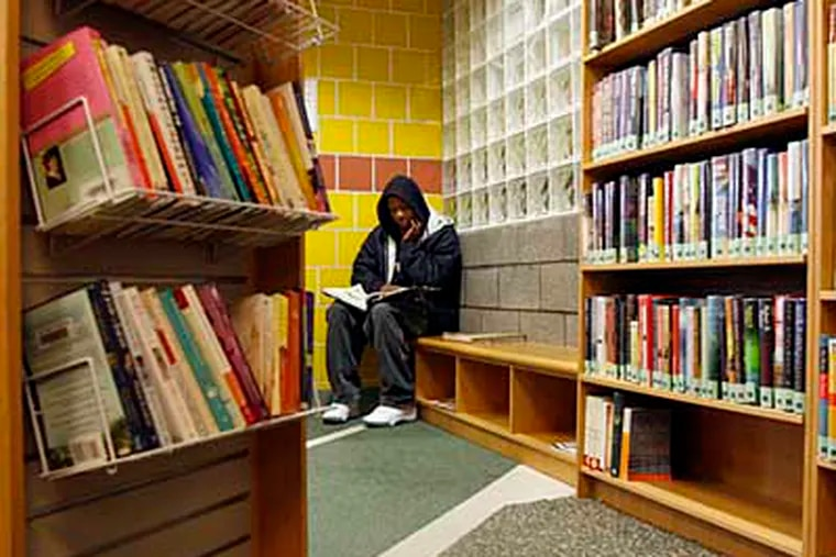 Damarkus Clark, 14, loves to read. He lives minutes from the library and spends time after school and on half-days reading there. The Fumo Family Branch of the Philadelphia Public Libraries will stay open. The branch was one of eleven to close tomorrow, Thursday, Dec. 31 ( Bonnie Weller / Staff ) PLib31-A. South Phila. Broad Street.