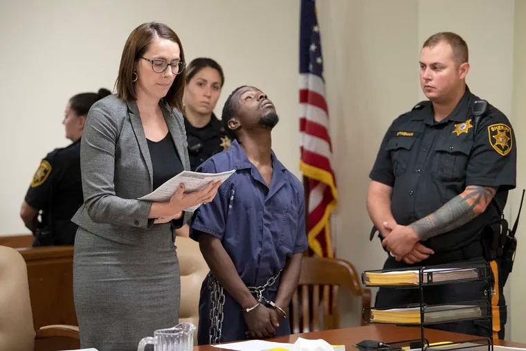 A defendant charged in a robbery linked to murder appears for his detention hearing next to his public defender, Margaret Butler, at the Camden County Superior Court.