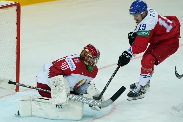 Alexei Kolosov of Belarus makes a save on the Czech Republic's Jakub Flek during the Ice Hockey World Championship Group A match at the Olympic Sports Center in Riga, Latvia, on May 24, 2021. The Flyers drafted Kolosov in the third round Saturday.