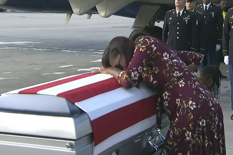 Myeshia Johnson cries over the casket of her husband, Sgt. La David Johnson, who was killed in an ambush in Niger, upon his body's arrival in Miami on Oct. 17.