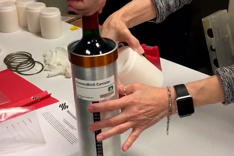 FILE - In this Saturday, Nov. 2, 2019 photo provided by Space Cargo Unlimited, researchers from the company prepare bottles of French red wine to be flown from Wallops Island, Va., to the International Space Station. On Monday, Jan. 11, 2021, the International Space Station bids adieu to 12 bottles of the French Bordeaux and hundreds of snippets of Merlot and Cabernet Sauvignon vines that spent a year orbiting the world in the name of science.