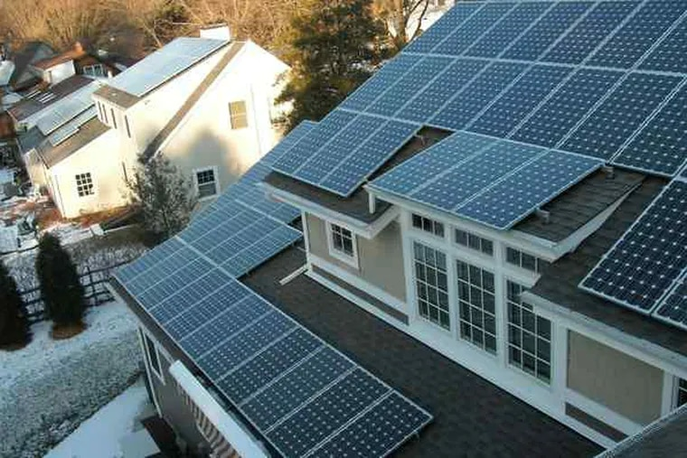 Phila. will be a hot spot next week when the brains and muscle of the solar tech industry gathers. Above, a solar photovoltaic installation on a house.