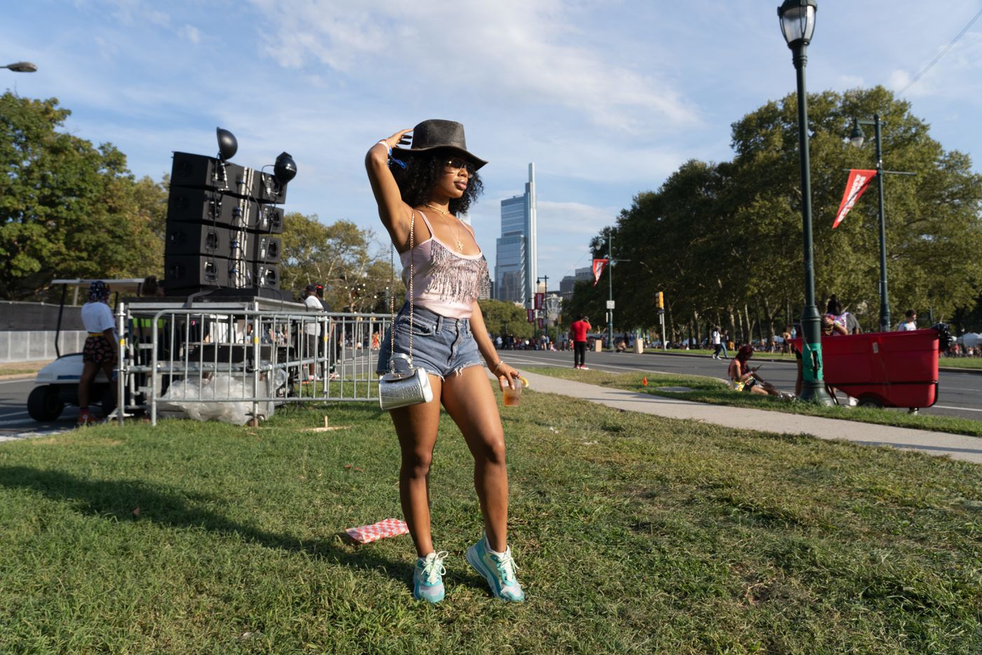 """Kennedy Johnson, 28 of Atlanta, wearing her outfit from a thrift store is at the Made in America Festival """"to see Cardi B, have fun and keep it authentic"""" on Benjamin Franklin Parkway in Center City, Philadelphia on Saturday, August 31, 2019."""