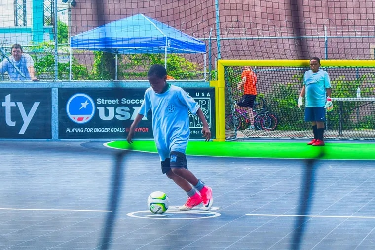 Street Soccer USA held a tournament at its court-style mini-pitch in Kensington on Aug. 4.