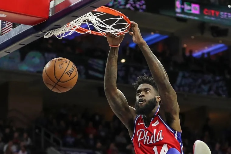 Sixers' Norvel Pelle dunks the ball in the fourth quarter of a game against the Brooklyn Nets at the Wells Fargo Center in Philadelphia on Wednesday, Jan. 15, 2020. Sixers won, 117-106.