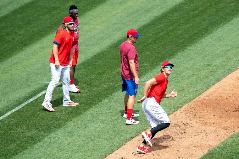 From left, Andrew McCutchen, Bryce Harper, Jay Bruce, and Rhys Hoskins, run the bases during Tuesday's practice.