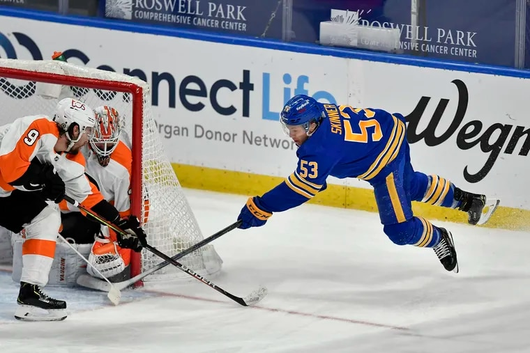 Sabres left wing Jeff Skinner tries to sneak one past Alex Lyon during the third period of Wednesday's 6-1 win, which snapped Buffalo's 18-game losing streak.