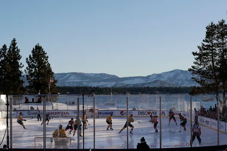 The Flyers take on the Boston Bruins during the first period in an outdoor NHL game on the 18th fairway of the Edgewood Tahoe Resort in Stateline, Nevada.