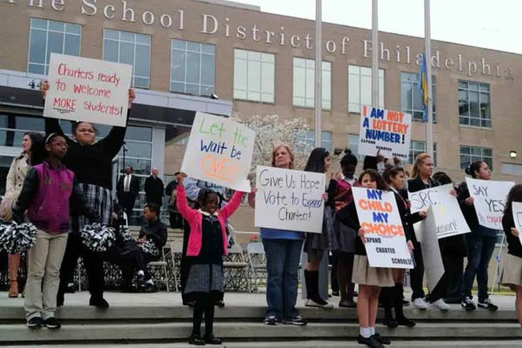 Students, parents, and supporters of charter schools rally outside the Philadelphia school administration building in 2013.