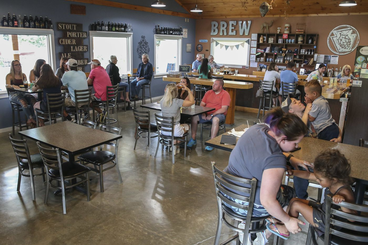 In a Pennsylvania 'green phase' county, people head out for haircuts, spin class, and pints of beer