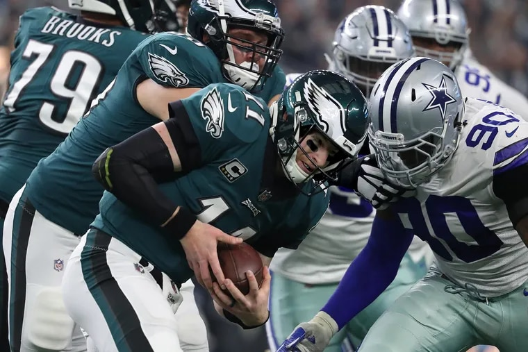 Carson Wentz is stopped by Cowboys defensive end Demarcus Lawrence during the second quarter.