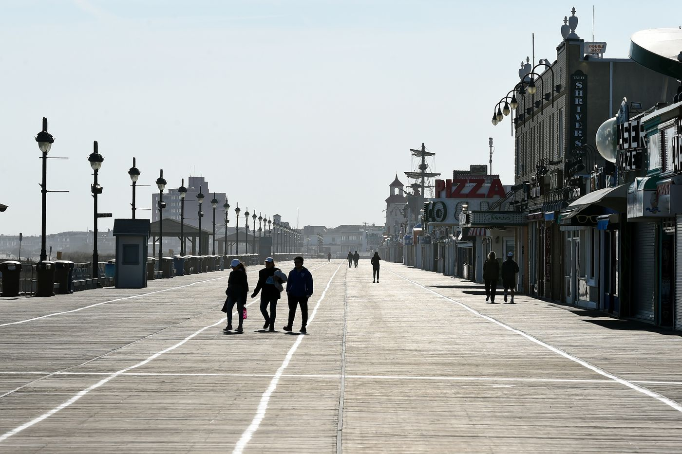 Pedestrians on the Boardwalk in Ocean City on Thursday, even as the city closed its beaches and boardwalk to keep people from spreading the coronavirus.