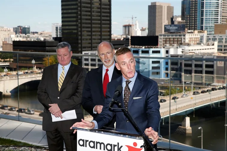 Philadelphia Mayor Kenney (left) and Pennsylvania Gov. Wolf,listen as Aramark Chairman Eric Foss announces Aramark's decision to move to 2400 Market St. The announcement event was held on Cira Green.