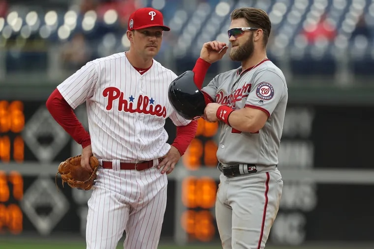 Rhys Hoskins, left, and Bryce Harper are both represented by agent Scott Boras.