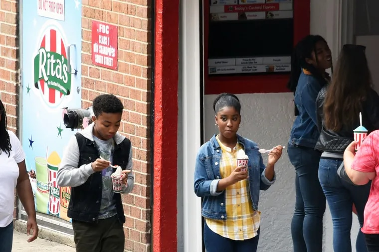 'This Is Us' star Lyric Ross (right) enjoys a water ice from Rita's while filming for season four of the NBC series on South Street.