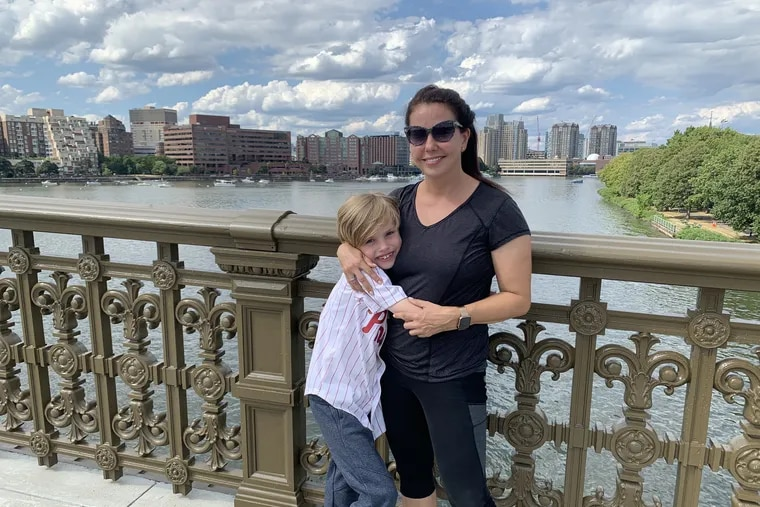 Nicole Henwood, with her son A.J., in Boston. A.J. has a rare disease known as NF2.