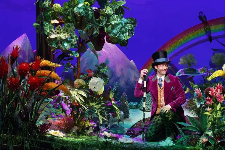 The actor Christian Borle playing Willie Wonka in Charlie and the Chocolate Factory. The Gold Ticket, a real scavenger hunt-like competition started by the founder of the Jelly Belly Candy Company, was meant to emulate that story by Roald Dahl.