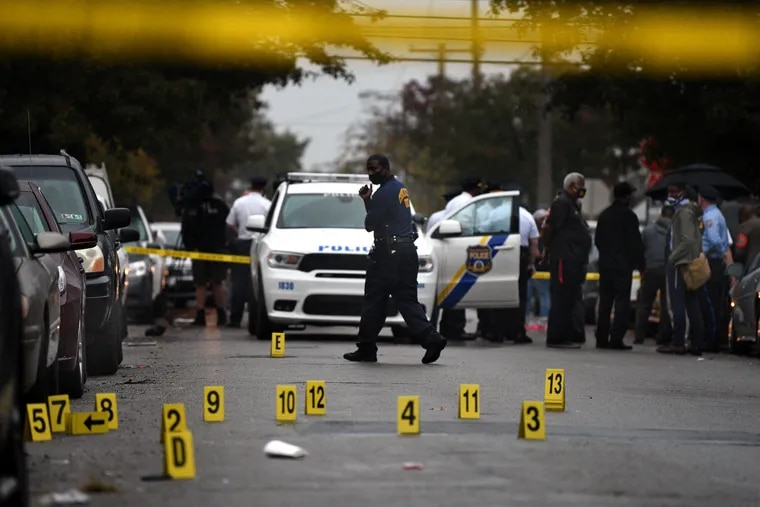 The scene on the 6100 block of Locust Street on Monday, after police officers fatally shot a 27-year-old man during a confrontation. He was later pronounced dead at the hospital
