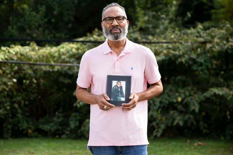 William James, father of Anrae James, holds a photograph of his son at his home in Elkins Park. Anrae James was killed early Monday morning at Thomas Jefferson University Hospital in Center City.