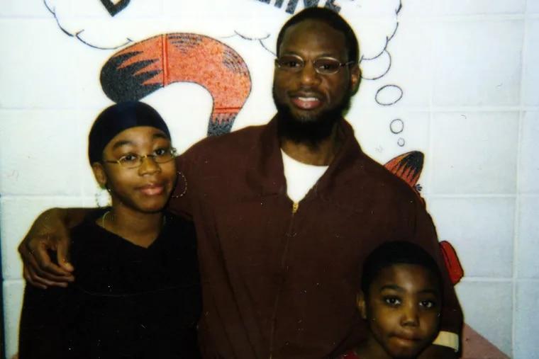 Stacey Torrance in 2003, with niece Alexis and nephew Zuri at the State Correctional Institution in Chester, where he is serving life. (FILE PHOTO)