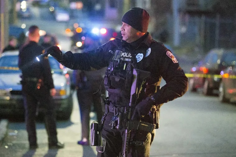 """Harrisburg Police block off sections of the street after a shooting, Friday, Dec. 22, 2017.  A prosecutor says there's """"no doubt"""" a gunman who fired at police in several locations in  the capital city before they shot and killed him was targeting police officers. Authorities say Ahmed Aminamin El-Mofty fired at a Harrisburg police officer on Friday afternoon and later at a state trooper, wounding her. They say he later approached police with two handguns and fired many shots at them before they returned fire and killed him."""