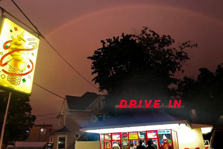 A rainbow forms briefly in the evening sky over the Maple Shade Custard Stand, in Maple Shade, a few minutes before sunset on July 22.