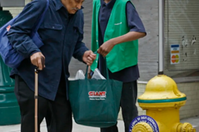 Charles Johnson gets help with his groceries from Isaiah White outside the Community Co-op. Surveys underestimate purchasing power in less-affluent areas, some analysts say.