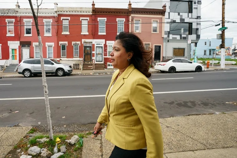 Councilwoman Maria Quinones-Sanchez, shown here in her district last year, sponsored an ordinance passed Thursday to create the Philadelphia Poverty Action Fund.