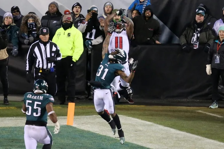 Eagles' corner Jalen Mills contests Falcons' receiver Julio Jones (11) on the Falcons' last chance to win the game. The Eagles won, 15-10, on Saturday.