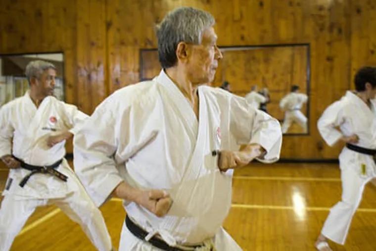 Mr. Okazaki works with students at his Phildelphia dojo.