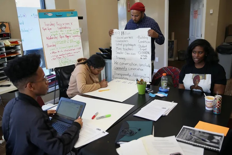 Youth activists opposed to a policy mandating the use of metal detectors in all Philadelphia public high schools shut down a school board meeting Thursday night. Shown here is Philadelphia Student Union executive director Julien Terrell (in hat), with students, as they prepared for the meeting earlier in the week.
