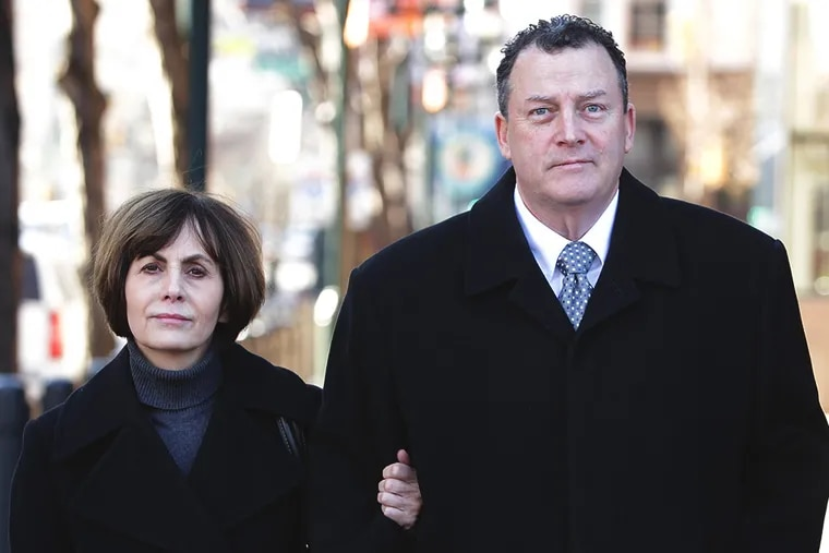Former Traffic Court Judge Robert Mulgrew, right, with his wife, Elizabeth, leaves the Federal Courthouse on February 6, 2014. Mulgrew has pleaded guilty to defrauding a South Philadelphia nonprofit and to filing false tax returns. ( DAVID MAIALETTI / Staff Photographer )