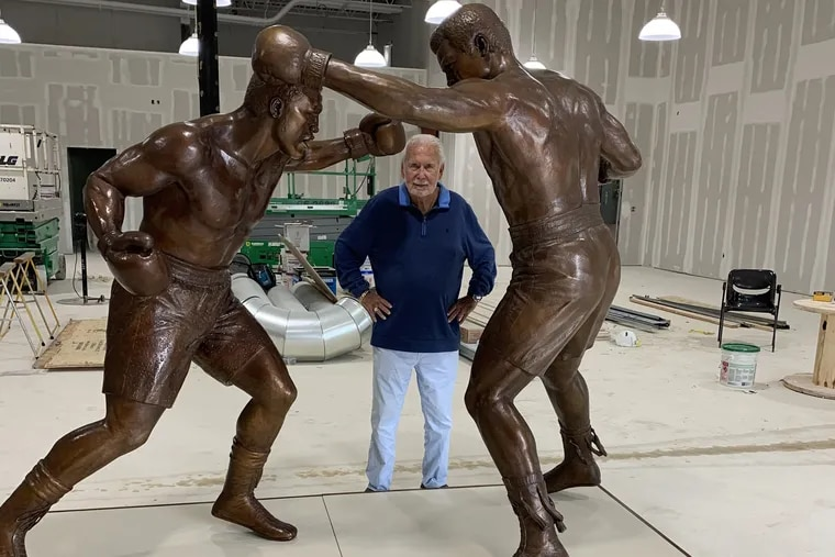 Joe Hand Sr. poses with the Ali-Frazier statue set to be unveiled on March 8, 2021.