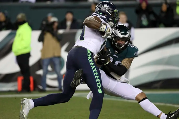 Eagles cornerback Avonte Maddox tries to take down Seattle Seahawks wide receiver D.K. Metcalf after a 53-yard reception during the third quarter.