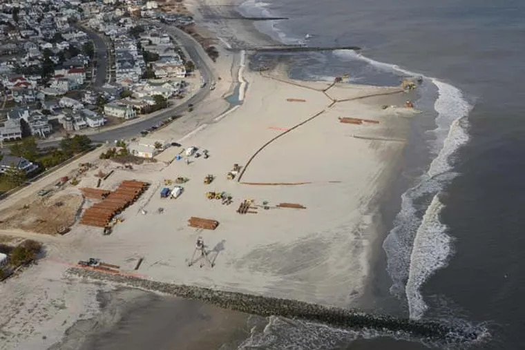 Beach Nourishment along the northern part of the Ocean City, New Jersey Beach continues today, February 20, 2013. Dredging operations by Great Lakes Dredge and Dock Corporation pump sand from dredge to the beaches of Ocean City, NJ. Photo By Gregg Kohl. Beaches being replenished are at Beach Road and East Atlantic Blvd, Ocean City, NJ