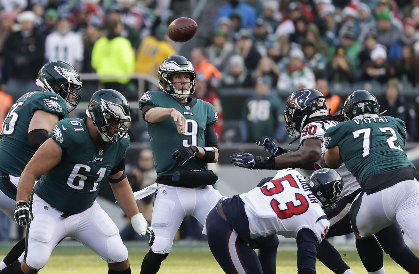 1ded3456e7c Eagles quarterback Nick Foles throws the football with offensive linemen  Lane Johnson