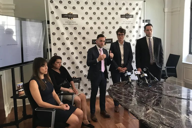 Flanked by two victims of alleged sexual assault at New Jersey Massage Envy spas, attorneys Guy D'Andrea, H. Nellie Fitzpatrick, and M. Stewart Ryan announce the filings of new charges against four Massage Envy locations in New Jersey.