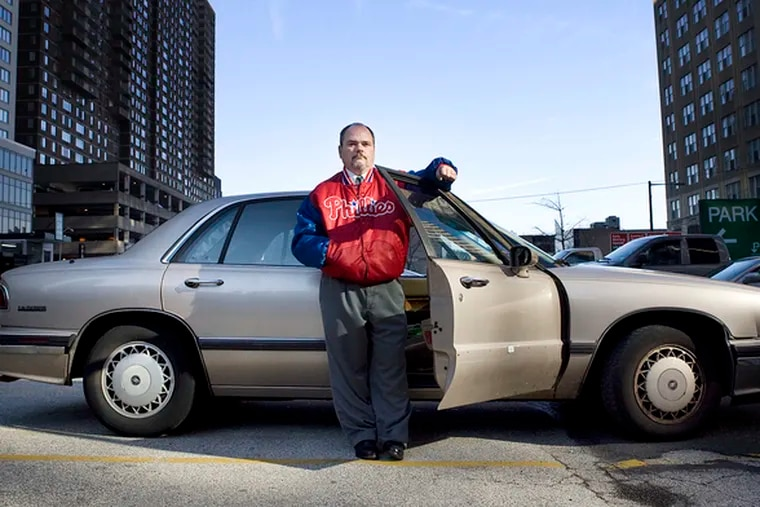 """John Adamson, a deaf man from Philadelphia, with his 1994 Buick. He claims Cherry Hill Dodge charged him an 18.95 """"disability"""" interest rate on a Caravan, then repossessed it without warning."""