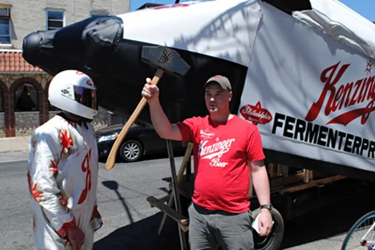 The Hammer of Glory is handed off today as Philly Beer Week commences.